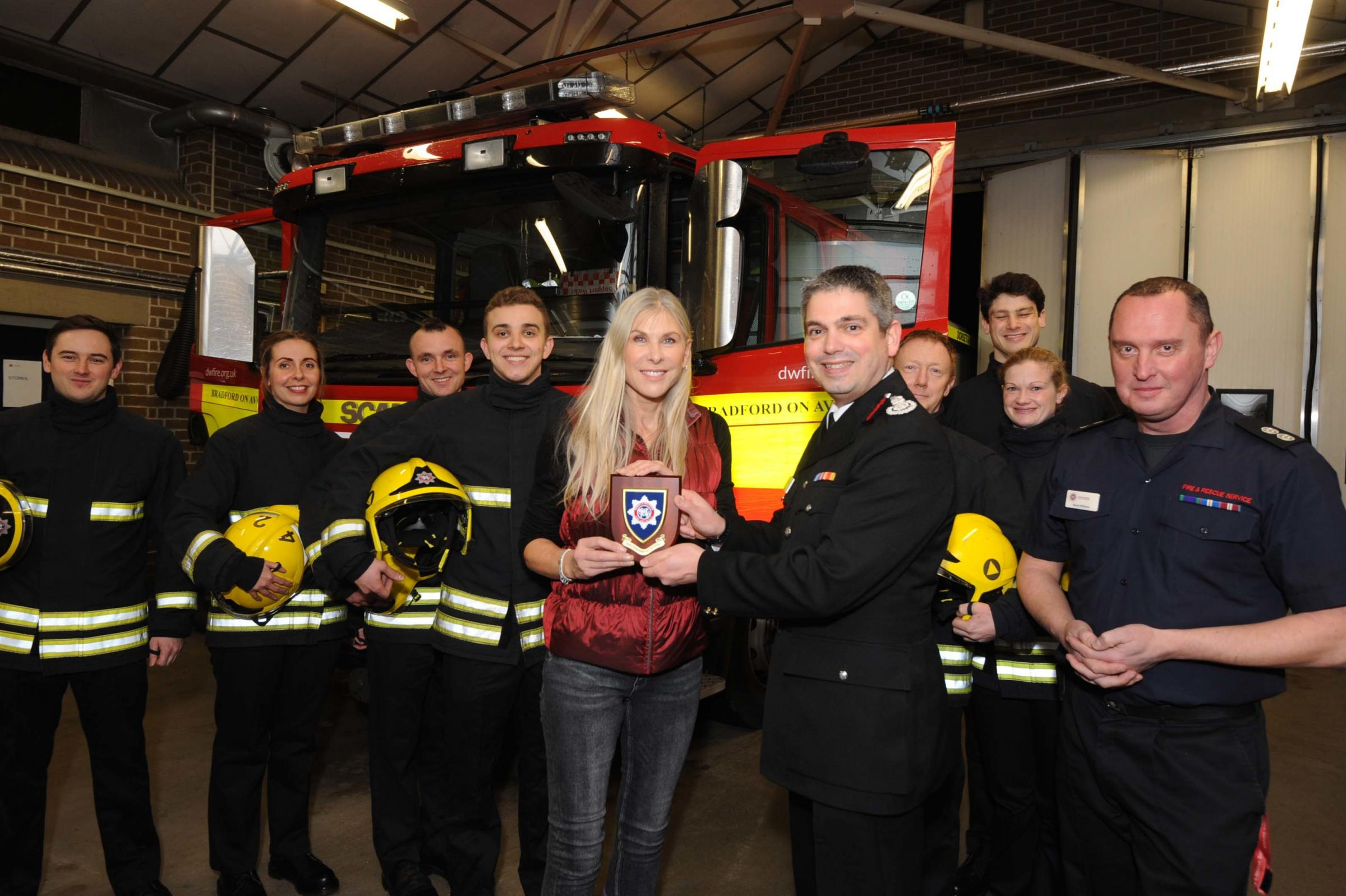 Former Olympic swimmer Sharron Davies thanks the Bradford on Avon firefighters to help with recruitment after a car blaze endangered her home. Dorset and Wiltshire Fire Chief Ben Ansell and the crew presented her with a memento of her visit Photo: Trevor