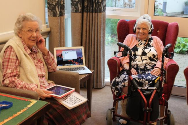 Residents at Wiltshire Heights play with the MindHarp equipment