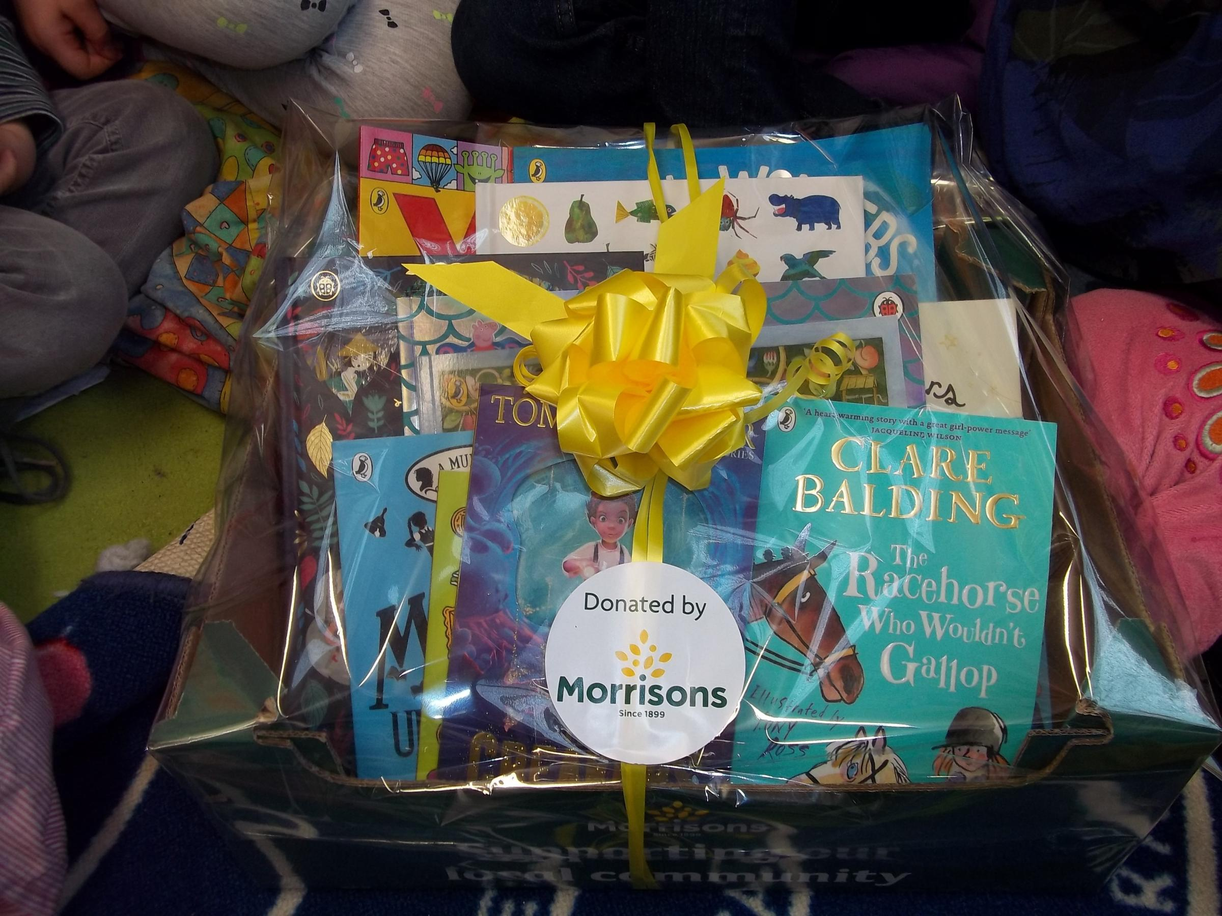 The basket of books donated by7 Morrisons to The Avenue School