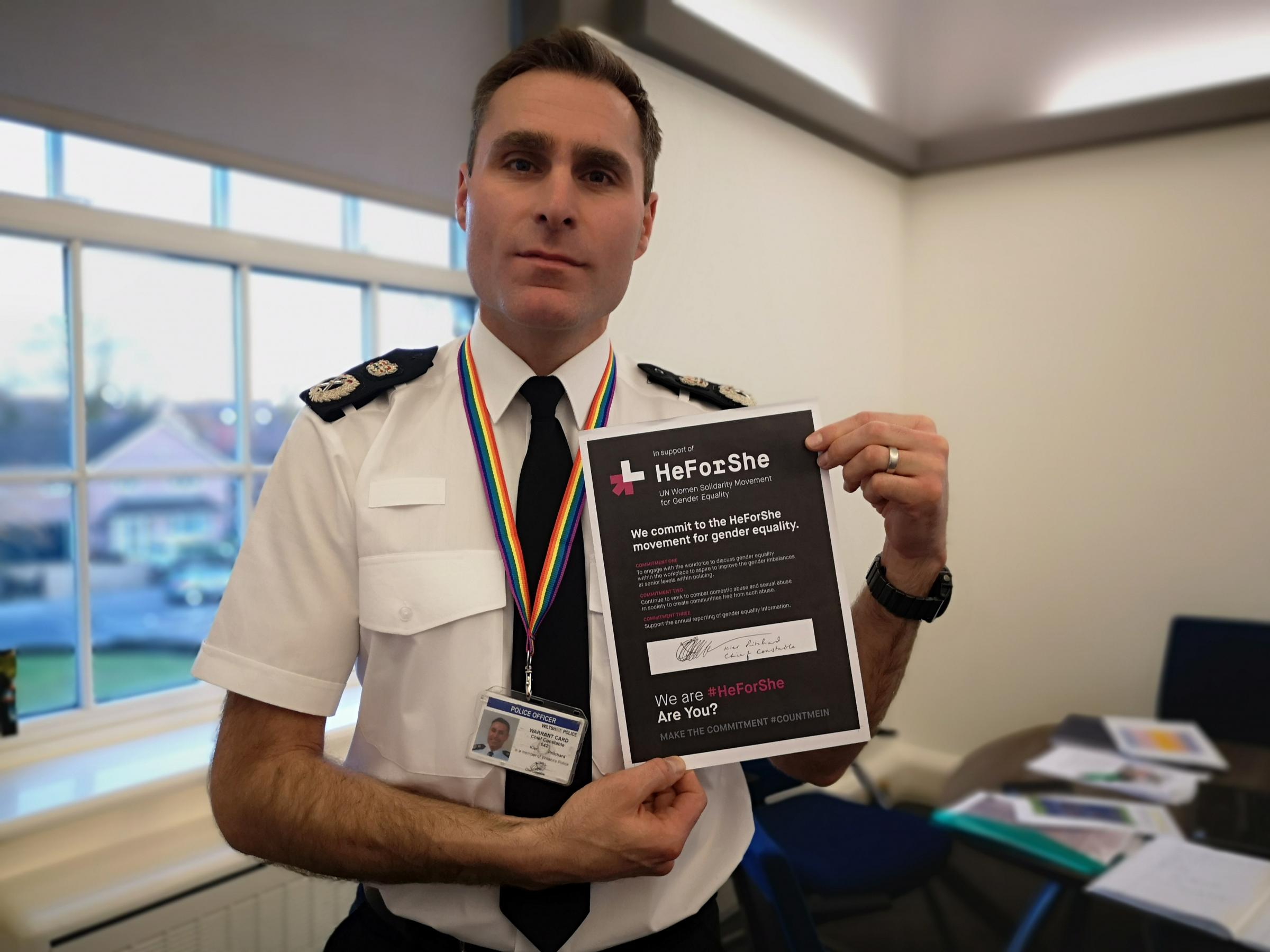 Chief Constable Kier Pritchard holds the signed HeForShe pledge