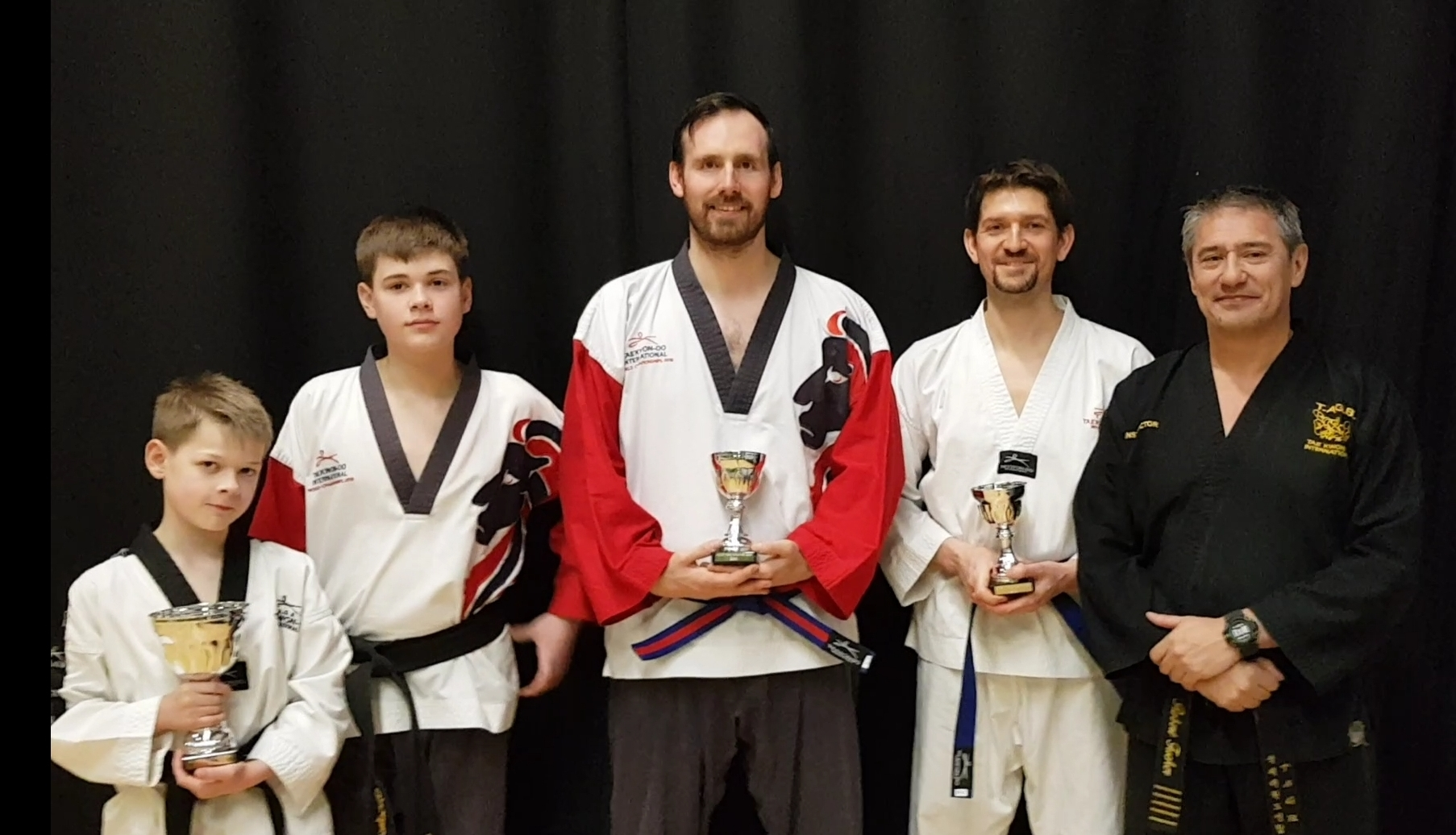 Trowbridge TAGB Tae Kwon Do instructor Rob Tucker with his successful students