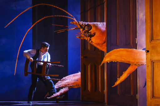 Tamino (Ben Johnson) battles the giant lobster with a chair in The Magic Flute at Bristol Hippodrome Photo: Bill Cooper