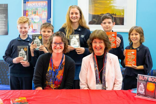 Author Geraldine McCaughrean with staff and pupils at St Laurence School.
