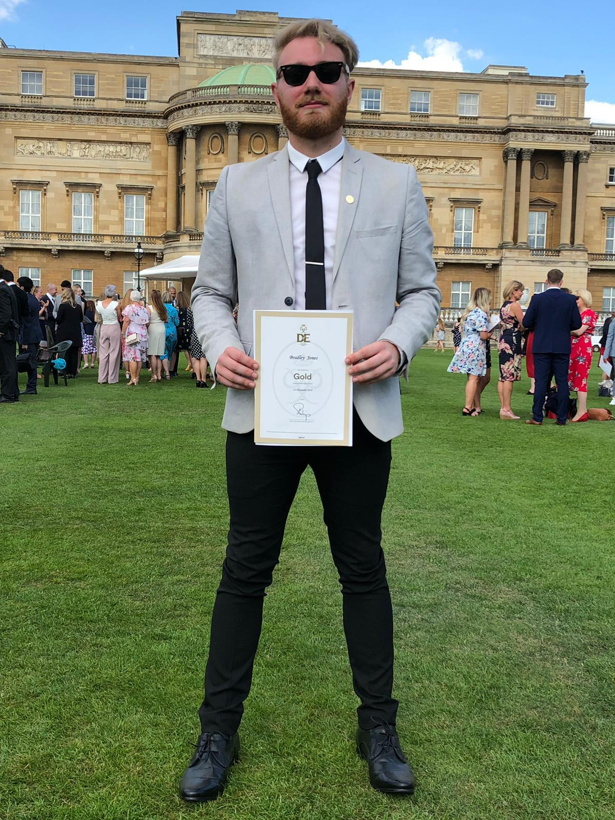 Bradley Jones with his DoE Gold Award at Buckingham Palace