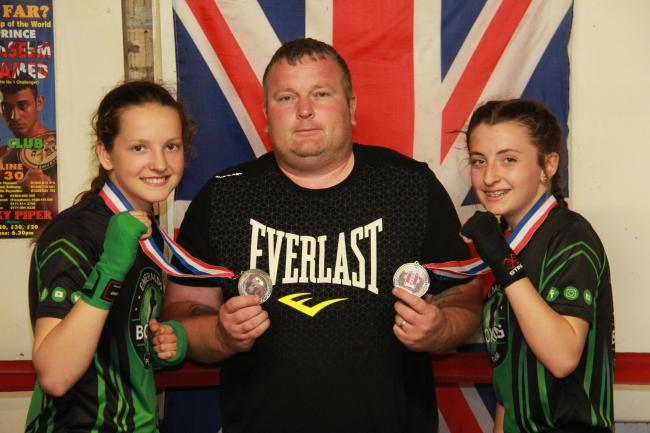 Emeralds ABC fighters Eloise Edwards and Katie Doig with club coach Liam Lathbury